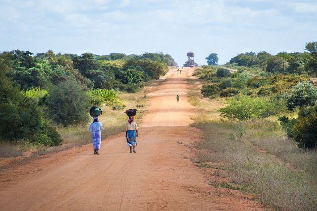 african-women-walking-along-road-